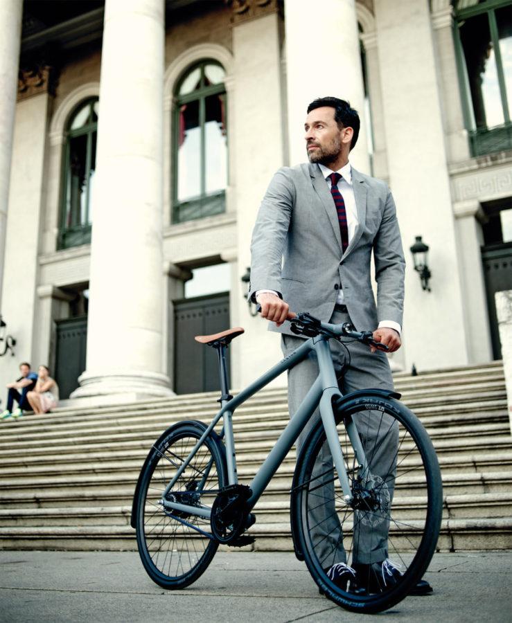 Man pushing bike